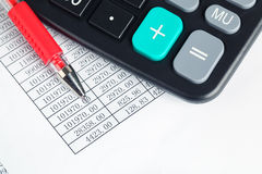 Calculator and red pen Royalty Free Stock Photography