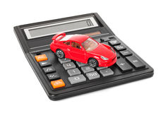 Calculator and red toy car Royalty Free Stock Photo
