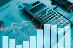 Calculator with report finance and profit graph of stock market. Trade indicator financial.Double exposure style Royalty Free Stock Image