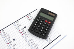 Calculator and reports Stock Photo