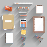 Calculator, ruler and paper on an office desk. Calculator, ruler, book and paper page icon on an office desk. Flat icon modern design style concept Stock Photography