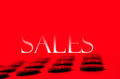 Calculator and sales. In red background Stock Photos