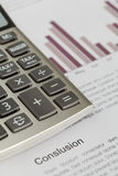 Calculator on sales report chart. Sales report document with calculator Stock Photo