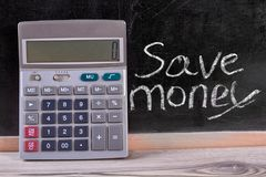 Calculator and save money concept. Close up. Calculations for saving money Royalty Free Stock Image