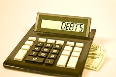 Calculator says 'DEBTS' Stock Images
