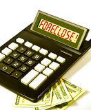 Calculator says 'FORECLOSE!'. Desktop calculator displays the word FORECLOSE! in red letters royalty free stock image