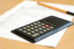 Calculator and sheet. Calculator on sheet of paper with pen royalty free stock photos