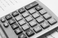 Calculator. On sheet of paper Stock Photography