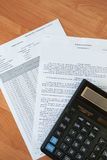Calculator with sheets of paper Royalty Free Stock Photo