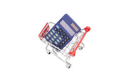 Calculator in shopping trolley cart Royalty Free Stock Image