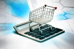 Calculator  with shopping trolley Stock Photo