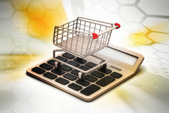 Calculator  with shopping trolley Stock Images