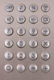 Calculator in silver stock photos
