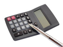 Calculator with silver pen isolation on white Royalty Free Stock Photos
