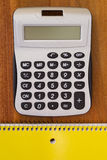 Calculator for simple calculations. And notebook to take notes Royalty Free Stock Image