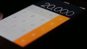 Calculator smartphone. Close-up stock video