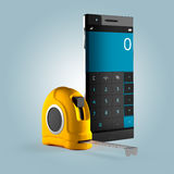 Calculator in the smartphone and measuring tape. On  background Royalty Free Stock Photos