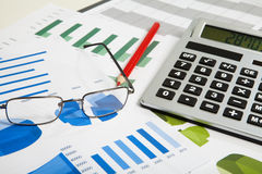 Calculator and spectacles Stock Images
