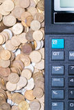 Calculator and a stack of coins Royalty Free Stock Images