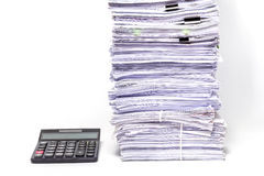 Calculator and Stack of Documents Stock Photo