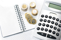 Calculator with Stacks of euros Stock Images