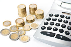 Calculator with Stacks of euros Stock Image