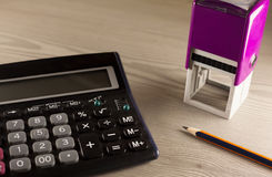 Calculator, stamp and pencil royalty free stock image