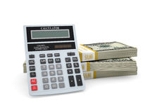 Calculator stand on pack of dollars Stock Photo