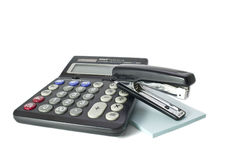 Calculator and stapler Royalty Free Stock Photo
