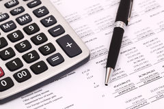 Calculator and stationery. Items on the table Royalty Free Stock Photography