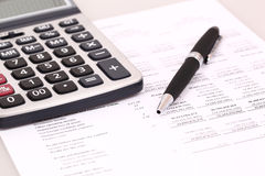 Calculator and stationery. Items on the table Stock Photography