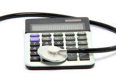 Calculator stethoscope Stock Photography