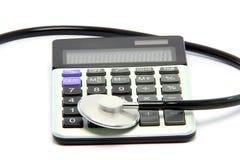 Calculator stethoscope Stock Photography