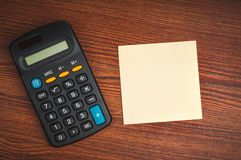 Calculator and sticker Royalty Free Stock Image