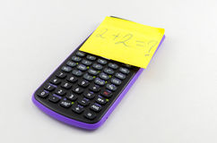 Calculator and sticky note Stock Images