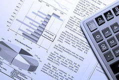Calculator and stock market report. Stock Image