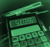 Calculator with success result Royalty Free Stock Photos