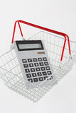 Calculator in supermarket basket Stock Photo