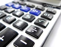 Calculator on the table Stock Images