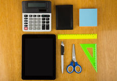 Calculator, tablet computer with chart and graphs, notepad Royalty Free Stock Photography