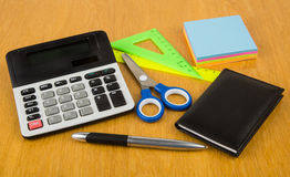 Calculator, tablet computer with chart and graphs, notepad Stock Image