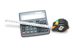 Calculator and tape measure is. Calculator  and tape measure isolated on white Royalty Free Stock Photography
