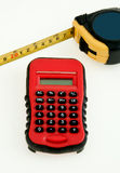 Calculator and Tape Measurer Stock Photo