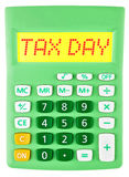 Calculator with TAX DAY on display on white Royalty Free Stock Photography