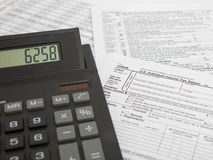 Calculator with tax form Stock Images