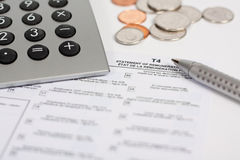 Calculator, Tax Form, Pen and Coins Stock Images
