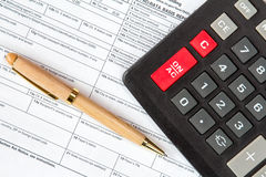 Calculator and tax form Stock Photo