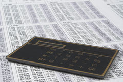 Calculator and tax tables Stock Images