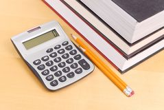 Calculator with Textbooks Royalty Free Stock Photography