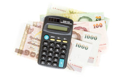 Calculator and thai bank notes on white background Stock Photo